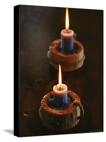 Two Candles in Rustic Candlesticks-Vlad Kharitonov-Stretched Canvas Print