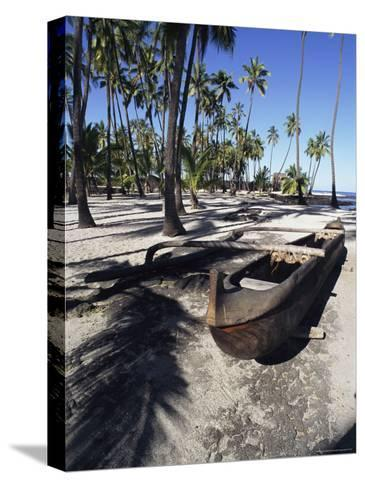 An Outrigger Canoe Rests on a Beach-Heather Perry-Stretched Canvas Print