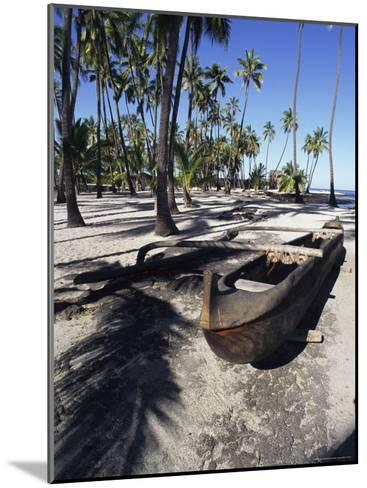 An Outrigger Canoe Rests on a Beach-Heather Perry-Mounted Photographic Print