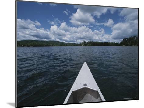 Bow of a Canoe Points Across Star Lake Toward the Horizon-Todd Gipstein-Mounted Photographic Print