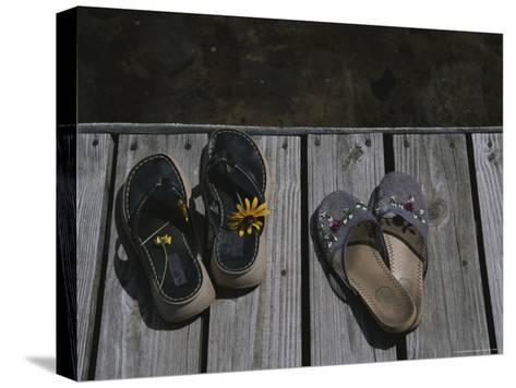 Flower Bedecked Sandals Rest Upon a Dock on Star Lake-Todd Gipstein-Stretched Canvas Print