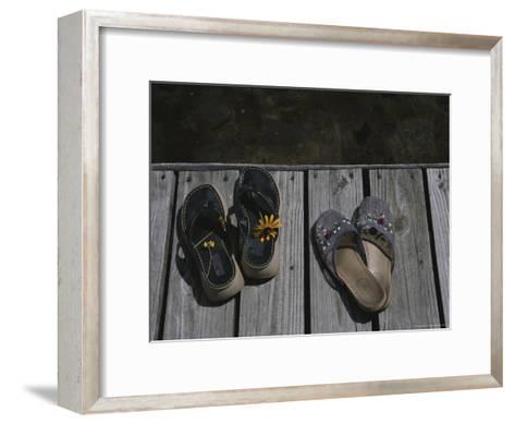 Flower Bedecked Sandals Rest Upon a Dock on Star Lake-Todd Gipstein-Framed Art Print