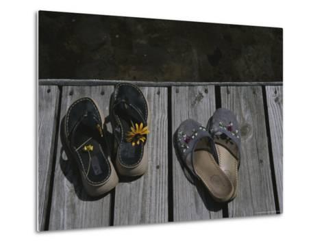 Flower Bedecked Sandals Rest Upon a Dock on Star Lake-Todd Gipstein-Metal Print