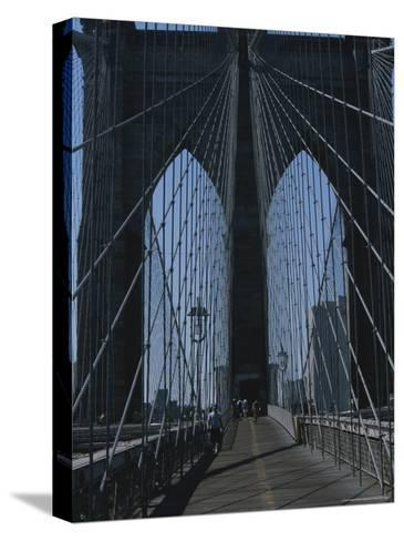Lattice-Like Cables Rise Above Pedestrians on the Brooklyn Bridge-Todd Gipstein-Stretched Canvas Print