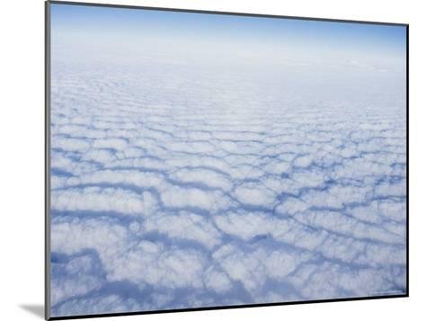 Cloud Pattern over the Pacific Ocean at 30,000 Feet-Rich Reid-Mounted Photographic Print