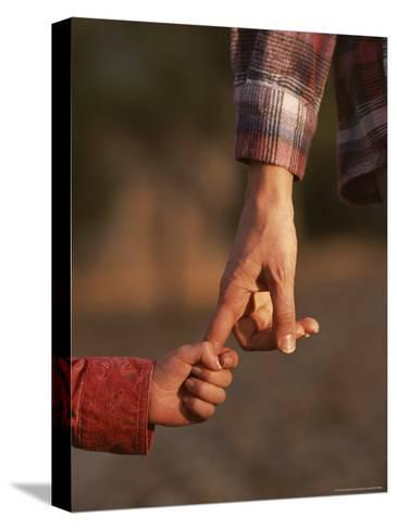 Touching Close-up of a Mother and Daughter Holding Hands-Phil Schermeister-Stretched Canvas Print