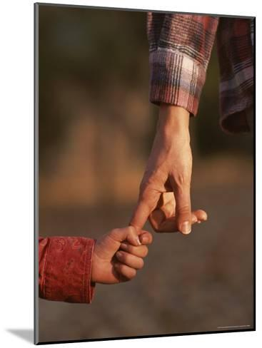 Touching Close-up of a Mother and Daughter Holding Hands-Phil Schermeister-Mounted Photographic Print