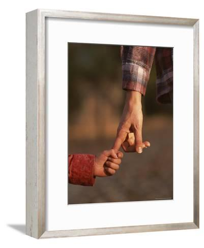 Touching Close-up of a Mother and Daughter Holding Hands-Phil Schermeister-Framed Art Print
