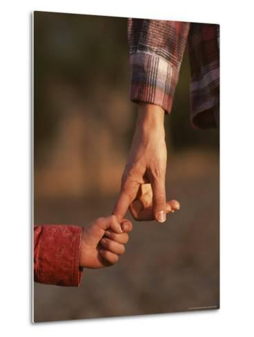 Touching Close-up of a Mother and Daughter Holding Hands-Phil Schermeister-Metal Print