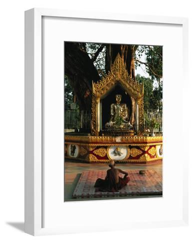 Buddhist Monk Meditating Near Altar with Buddha Statue and Gilt-Steve Winter-Framed Art Print