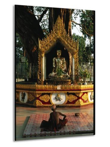 Buddhist Monk Meditating Near Altar with Buddha Statue and Gilt-Steve Winter-Metal Print
