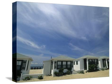 Row of Small Cottages Along the Beach at North Truro-Michael Melford-Stretched Canvas Print