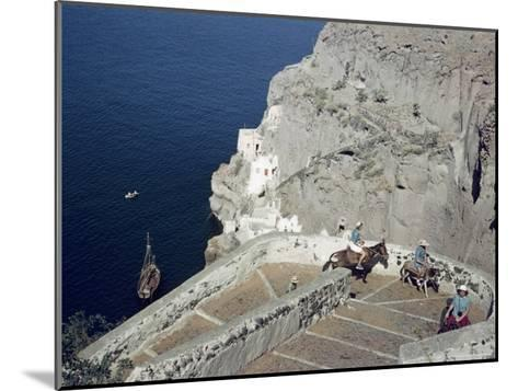 Donkeys Carry Visitors From the Ocean To the Hilltop Town of Thera-Maynard Owen Williams-Mounted Photographic Print