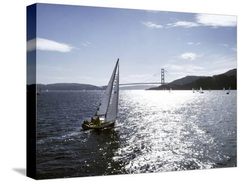 Boat Sails Toward the Golden Gate Bridge on San Francisco Bay-Rex Stucky-Stretched Canvas Print
