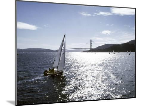 Boat Sails Toward the Golden Gate Bridge on San Francisco Bay-Rex Stucky-Mounted Photographic Print