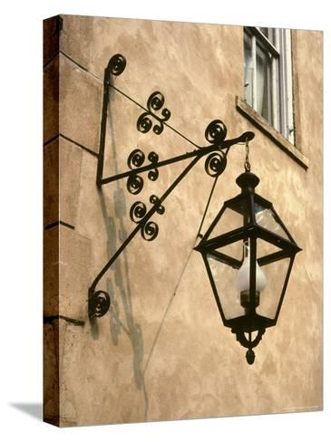Iron Street Lamp Hangs From a Historic Building-Rex Stucky-Stretched Canvas Print