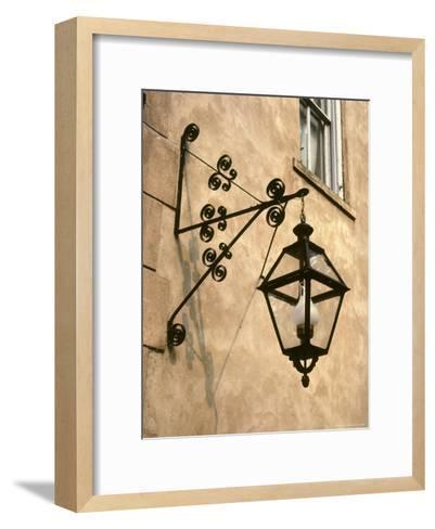 Iron Street Lamp Hangs From a Historic Building-Rex Stucky-Framed Art Print