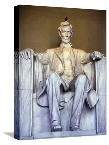 Bird Perches on Abraham Lincoln's Statue Inside the Lincoln Memorial-Rex Stucky-Stretched Canvas Print