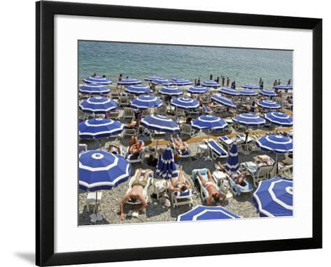 Blue Umbrellas and People Crowd Beach-Russell Mountford-Framed Art Print