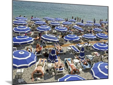 Blue Umbrellas and People Crowd Beach-Russell Mountford-Mounted Photographic Print
