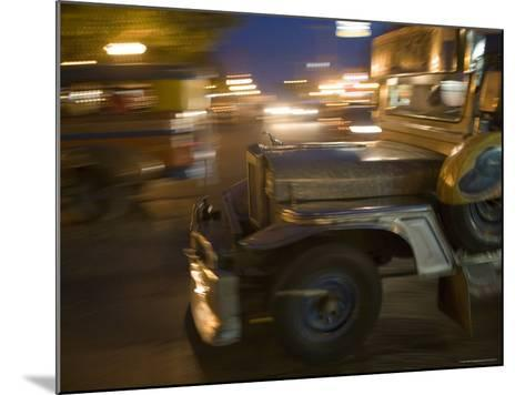 Jeepney Speeds Through Night in Malate-Greg Elms-Mounted Photographic Print