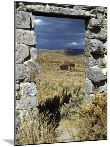 1880's Deserted Home Through Stone Warehouse Door Frame, Bodie State Historic Park-Emily Riddell-Mounted Photographic Print