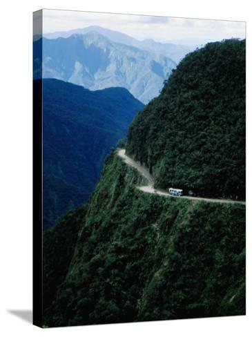 Bus Travelling the World's Most Dangerous Road-Craig Pershouse-Stretched Canvas Print