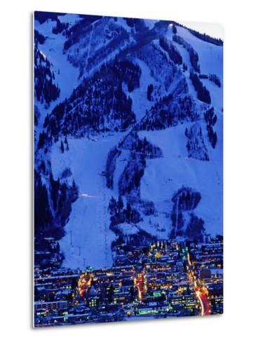 Town Illuminated at Dusk with Aspen Mountain Towering Above-Diego Lezama-Metal Print