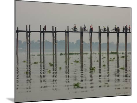 People Ride their Bicycles Along U Bein's Bridge That Runs Down the Taungthaman Lake-David Greedy-Mounted Photographic Print
