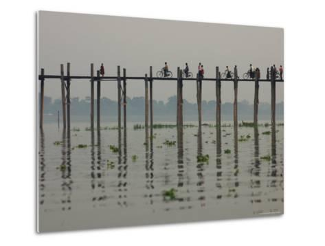 People Ride their Bicycles Along U Bein's Bridge That Runs Down the Taungthaman Lake-David Greedy-Metal Print