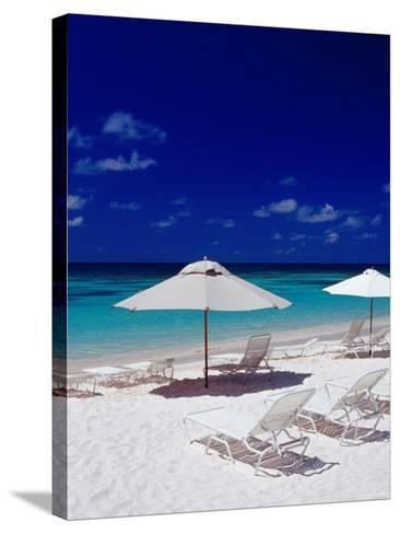 Beach Chairs and Umbrellas on Long Bay Beach-Richard I'Anson-Stretched Canvas Print