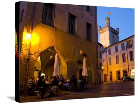 Outdoor Dining in Uzes, with Duche D'Uzes Illuminated at Dusk-Glenn Beanland-Stretched Canvas Print