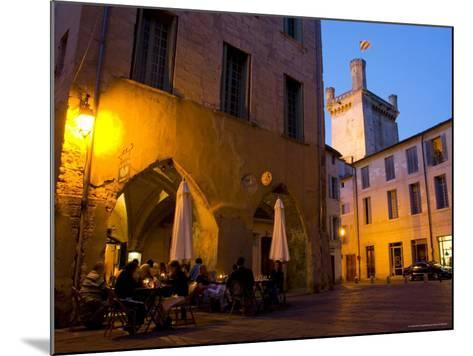 Outdoor Dining in Uzes, with Duche D'Uzes Illuminated at Dusk-Glenn Beanland-Mounted Photographic Print