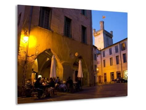 Outdoor Dining in Uzes, with Duche D'Uzes Illuminated at Dusk-Glenn Beanland-Metal Print