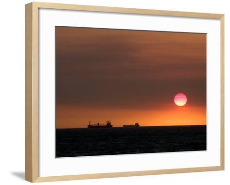 Cargo Ships Silhouetted on Horizon at Sunset, Cottesloe Beach-Orien Harvey-Framed Art Print