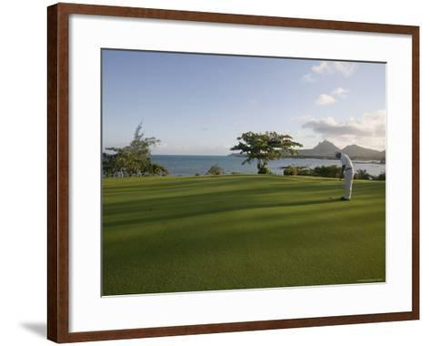 Men Playing Golf on Le Touessrok Golf Course-Holger Leue-Framed Art Print