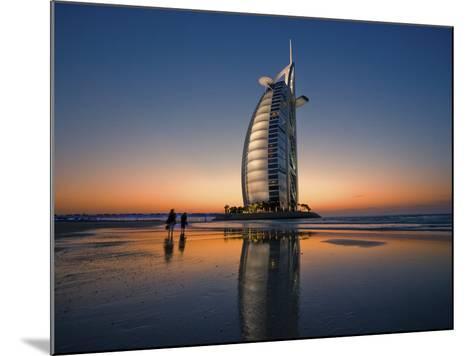 Burj Al Arab Hotel Reflected on Beach at Sunset-Merten Snijders-Mounted Photographic Print