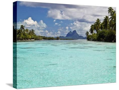 Bora Bora at End of Channel Between Two Motus in Taha'a Lagoon-Emily Riddell-Stretched Canvas Print