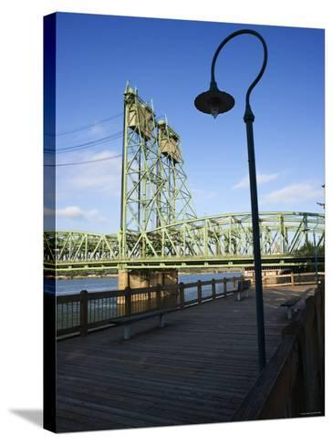 Boardwalk Along River with Industrial Bridge in the Background in Portland, Oregon--Stretched Canvas Print