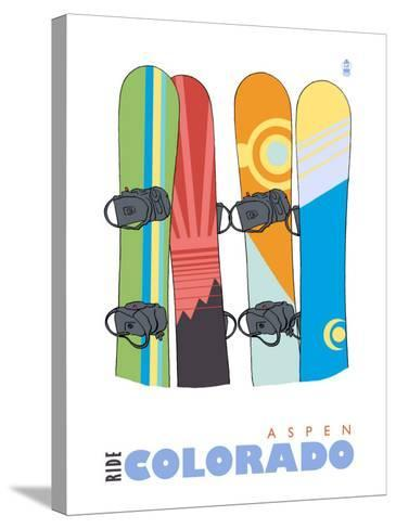 Aspen, Colorado, Snowboards in the Snow-Lantern Press-Stretched Canvas Print
