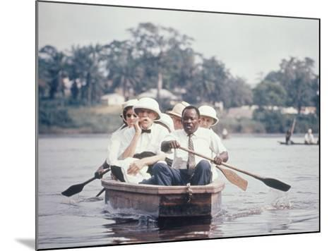 Dr. Albert Schweitzer Going Down the Ogowe River to Lambarene for His Birthday Celebration-George Silk-Mounted Premium Photographic Print