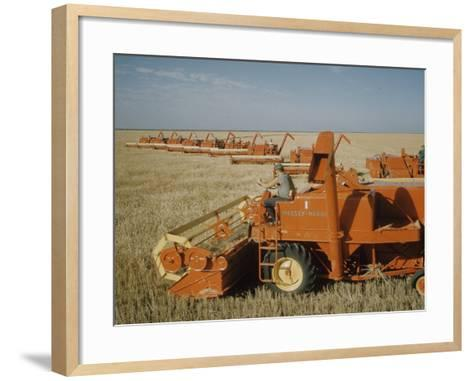 Harvest Story: Combines Harvest Wheat at Ranch in Texas-Ralph Crane-Framed Art Print