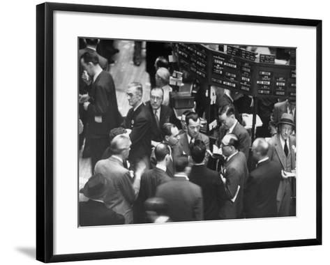 People Crowding the Stock Exchange Building-Charles E^ Steinheimer-Framed Art Print