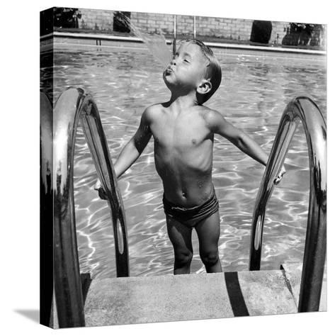 Duncan Richardson, 3-Year-Old Swimming Prodigy, Spouting Water Like a Whale, Town House Pool-Martha Holmes-Stretched Canvas Print