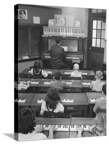 Elementary School Music Teacher Playing F Major Chord On Piano Keys