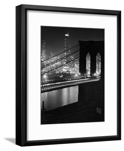 Glittering Night View of the Brooklyn Bridge Spanning the Glassy Waters of the East River-Andreas Feininger-Framed Art Print