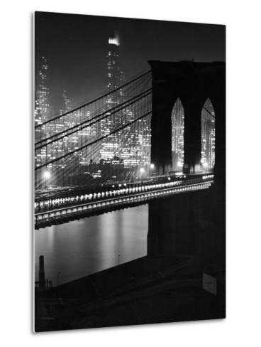 Glittering Night View of the Brooklyn Bridge Spanning the Glassy Waters of the East River-Andreas Feininger-Metal Print
