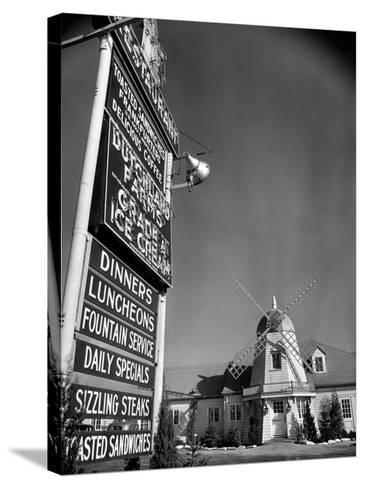 Electric Sign in Front of Restaurant Featuring Dutch Windmill Theme on Roadside of US Highway 1-Margaret Bourke-White-Stretched Canvas Print