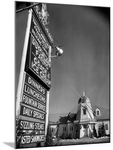 Electric Sign in Front of Restaurant Featuring Dutch Windmill Theme on Roadside of US Highway 1-Margaret Bourke-White-Mounted Photographic Print