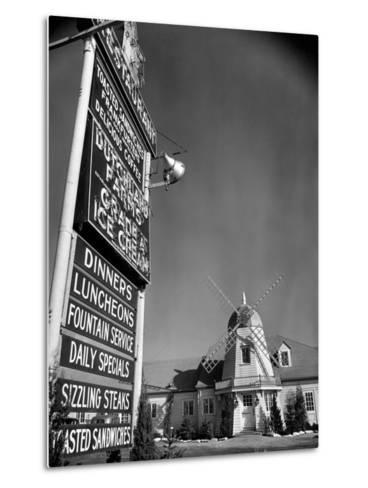 Electric Sign in Front of Restaurant Featuring Dutch Windmill Theme on Roadside of US Highway 1-Margaret Bourke-White-Metal Print